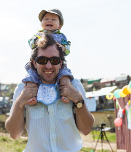 Toddler being carried on Dad's shoulders